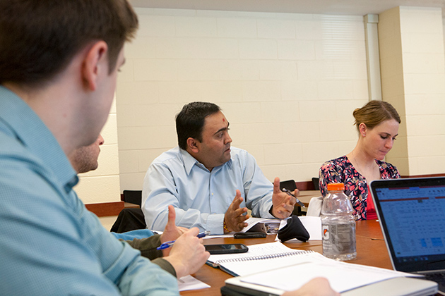 Ph.D. student Vishal Dhagat speaks during the class. (Sean Flynn/UConn Photo)
