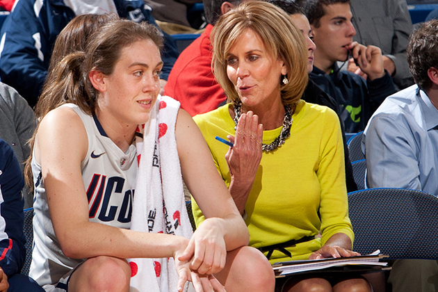 Associate Head Coach Chris Dailey on the bench during a game. (Photo courtesy of UConn Athletics)