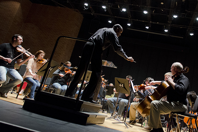 Director Harvey Felder conducts students from the UConn Symphony Orchestra as they rehearse in von der Mehden Recital Hall on Feb. 16, 2013. (Ariel Dowski/UConn Photo)