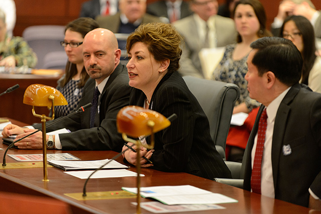 President Susan Herbst testifies in support of the Next Generation Connecticut initiative at a meeting of the finance committee of the state legislature on March 4. Seated with her are Monica Smith '14 (ENG), left, Stephen Szymanski, business manager at Proton Energy Systems of Wallingford, and Provost Mun Choi. (Peter Morenus/UConn Photo)