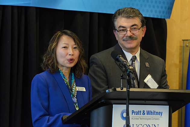 Agnes Klucha, program manager at Pratt & Whitney, and Kazem Kazerounian, interim dean of the School of Engineering, speak at the April 5 event. Pratt & Whitney engineers and UConn faculty and students will work together at the new center. (Ariel Dowski '14 (CLAS)/UConn Photo)