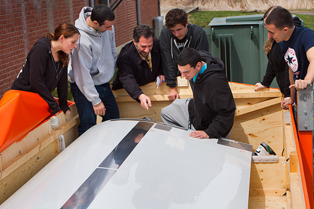 Michael Accorsi, senior associate dean for the University of Connecticut's School of Engineering, talks to students about an Airbus aircraft flap assembly recently delivered to the University's Depot Campus. Airbus, the world's leading commercial aircraft manager, donated the flap to UConn for research and training. (Chris LaRosa/UConn Photo)