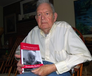 Director emeritus of University Libraries Norman Stevens, with Francelia Butler's autobiography, which he edited. (Suzanne Zack, UConn Photo)