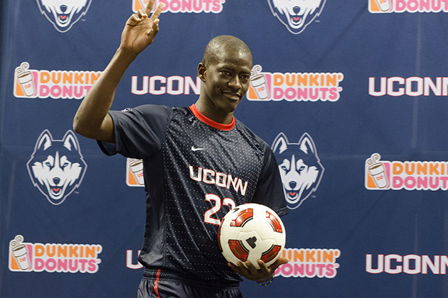 Mamadou Doudou Diouf '14 (CLAS) models a new soccer uniform during a ceremony held at Gampel Pavilion on April 18, 2013. (Peter Morenus/UConn Photo)