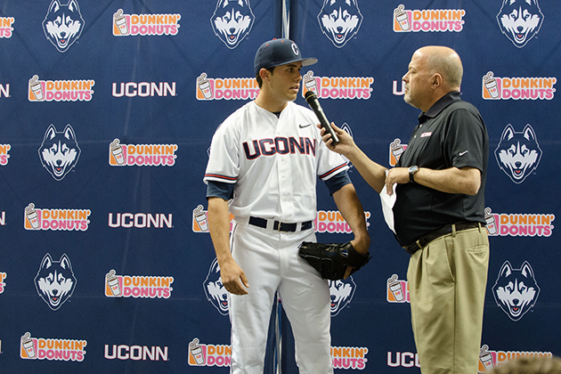 Joe D'Ambrosio, center, interviews Connor David '15 (CLAS) during a ceremony to unveil new athletic uniforms at Gampel Pavilion on April 18, 2013. (Peter Morenus/UConn Photo)