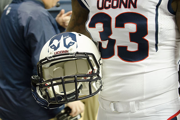 Yawin Smallwood '15 (CLAS) models a holds a new football helmet during a ceremony held at Gampel Pavilion on April 18, 2013. (Peter Morenus/UConn Photo)