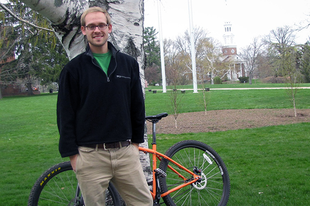 Mark Smith '13 MS Geoscience major and Innovation Quest award winner stands with his bicycle outside Beach Hall on April 29, 2013. (Sheila Foran/UConn Photo)