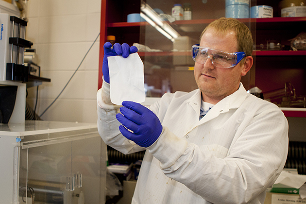 Jeffrey McCutcheon, assistant professor of chemical and biomolecular engineering. McCutcheon's lab specializes in making nanofiber nonwovens (pictured here) through a process called electrospinning. These materials have applications in water treatment, energy production, sensors and tissue engineering. (Chris LaRosa/UConn Photo)