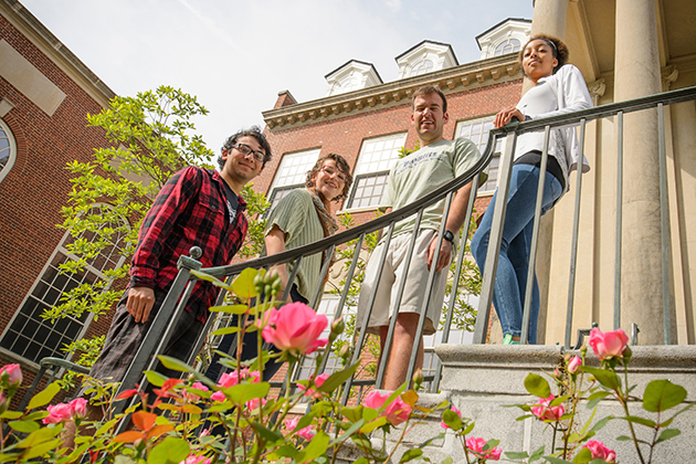 McNair scholars Luis Organista, '14 (CANR), left, Angelina Hernandez '14 (CLAS), Robert Stickels '15 (CLAS) and Tiahna Spencer '15 (CLAS) at the Wilbur Cross Buildin.. (Peter Morenus/UConn Photo)