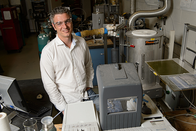 George Bollas, assistant professor of chemical materials and biomolecular engineering at his lab at the UConn Center for Clean Energy Engineering on July 24, 2013. (Peter Morenus/UConn Photo)