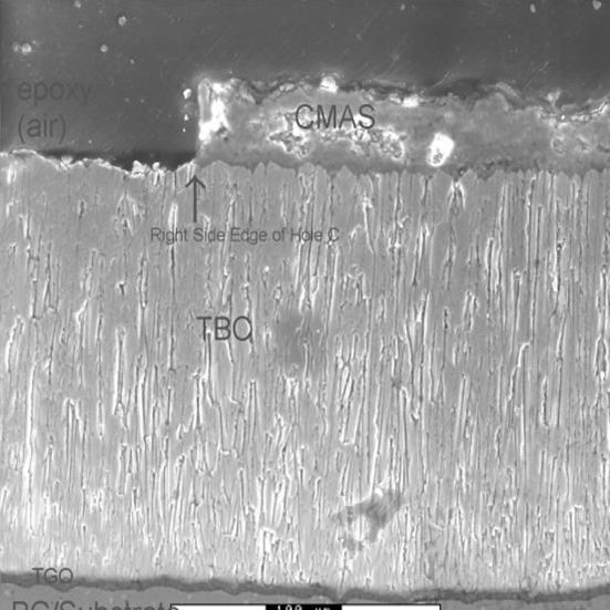 An image showing the successful laser ablation of contaminants from the thermal barrier coating on the surface of a turbine engine blade. (Image courtesy of Michael Renfro/Surface & Coatings Technology)
