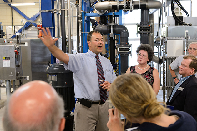 Ron Gaudet, director of utilities, leads a tour of the plant during an event to celebrate the opening of the Water Reclamation Facility on July 10, 2013. (Peter Morenus/UConn Photo)