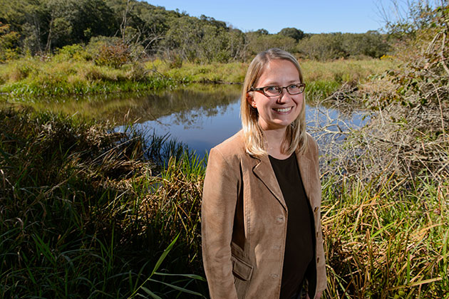 Tracy Rittenhouse, assistant professor of natural resources and the environment, near a wetland adjacent to the Fenton River. (Peter Morenus/UConn Photo)