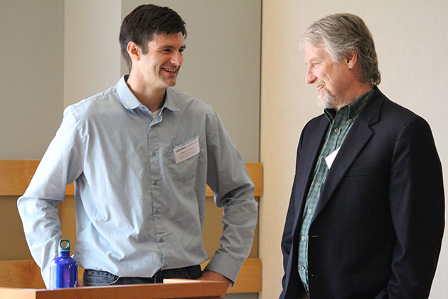 Associate Professor of Ecology and Evolutionary Biology Mark Urban talks with Michael Barney '75 (BUS), '77 MBA. (Christine Buckley/UConn Photo)