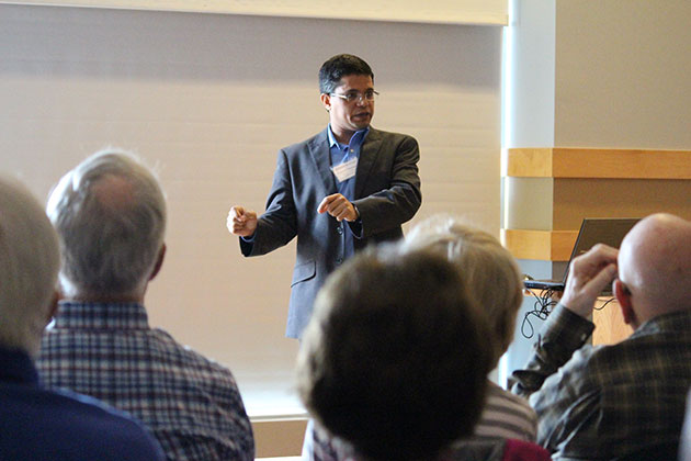 Prakash Kashwan, assistant professor of political science, talks about the economics of the services that the environment provides to people at the College of Liberal Arts and Sciences Alumni College Experience. (Christine Buckley/UConn Photo)