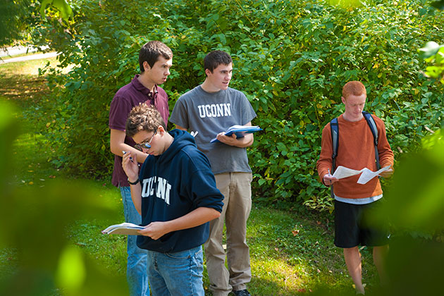 From left, Tim Lucas '17, Matt Kren '17, Tyler McCutcheon '16, and Donovan Fifield. An outdoor geography class introducing the environmental processes and patterns, especially assessing change in environmental systems using spatial analysis techniques. (Sean Flynn/UConn Photo)