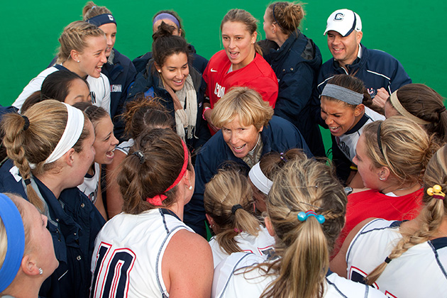 UConn's head field hockey coach Nancy Stevens is the all-time winningest coach in NCAA Division I history, with a career record of 562 wins. She is shown here with the 2012 team. (Steve Slade '89 (SFA) for UConn)