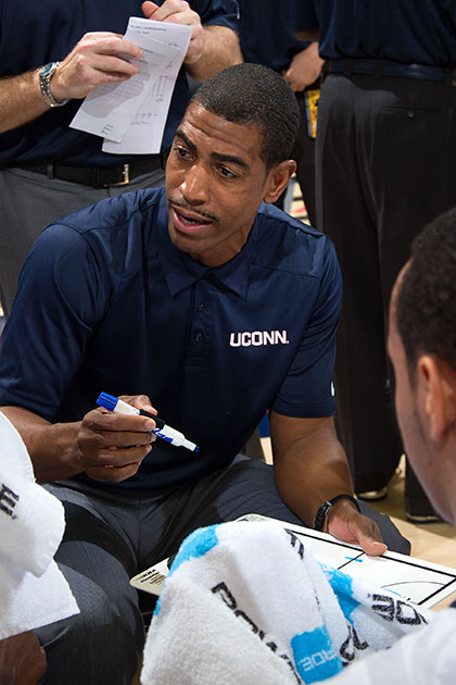Head coach Kevin Ollie explains a play to his team during the exhibition game against Southern Connecticut State University on Oct. 30. (Stephen Slade '89 (SFA) for UConn)