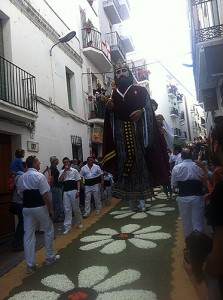 P10-foot-tall puppets dance through the streets on a carpet of flowers in Sitges, Spain.