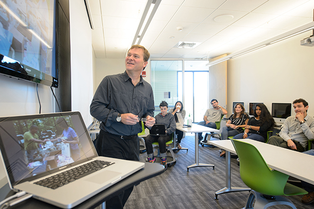 Steven Smith, assistant professor of journalism, leads a critique during a photojournalism class at Oak Hall on Sept. 17, 2013. (Peter Morenus/UConn Photo)