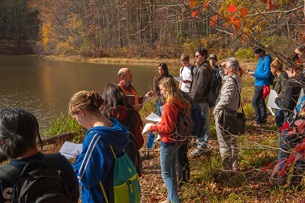 Robert Thorson, professor of ecology and evolutionary biology, addresses an honors class during a field trip to Tift Pond in the Albert E. Moss Sanctuary. (Sean Flynn/UConn Photo)