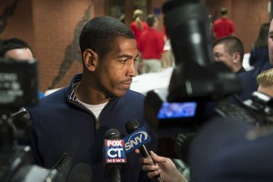 UConn men's head basketball coach Kevin Ollie '95 (CLAS) speaks with members of the media before the First Night show at Gampel Pavilion in October 2012. (Peter Morenus/UConn Photo)