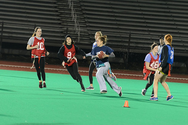 An intramural flag football game takes place under the new lights at the Sherman Sports Complex. (Ariel Dowski '14 (CLAS)/UConn Photo)