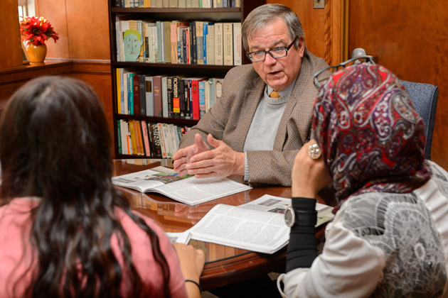 Walter Woodward, associate professor of history, meets with honors students Reem Elazazy '16 (CLAS), right, Halima Khan '16 (CLAS), Hayley Snell '16 (CLAS), and Moeizza Malik '16 (CLAS) on Nov. 4, 2013. (Peter Morenus/UConn Photo)