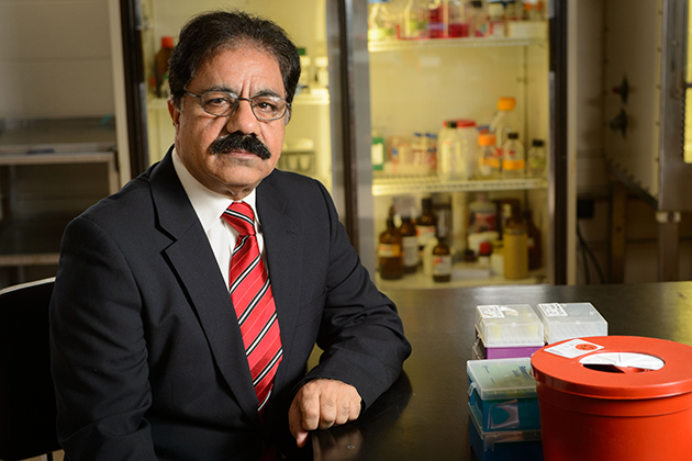Pathobiologist Mazhar Khan earned accolades in China for his research developing diagnostic tests and vaccines to help prevent the spread of avian influenza. (Peter Morenus/UConn Photo)