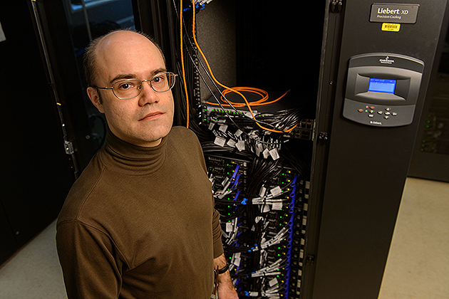 Serge Nakhmanson, associate professor of chemical, materials, & biomolecular engineering, in a server room at the Taylor L. Booth Engineering Center for Advanced Technology. (Peter Morenus/UConn Photo)