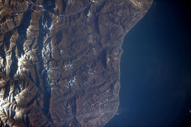 In this wider-angle photo of Sochi from space, the snow is more clearly visible in the mountains.