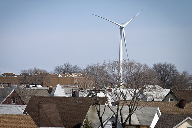 A wind turbine in a densely populated area. (iStock Photo)