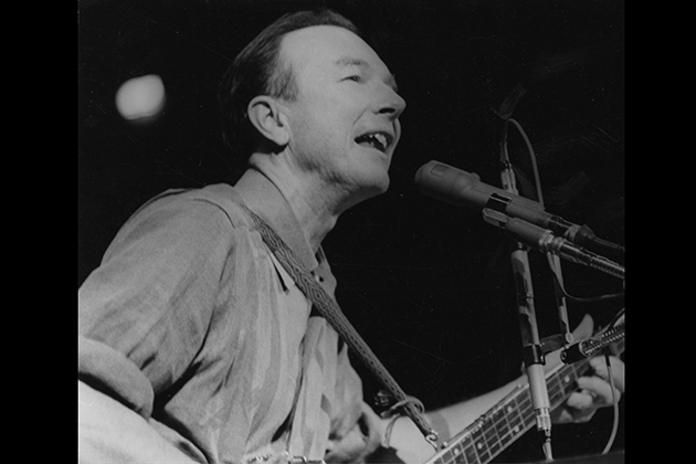 Pete Seeger performs at a 1965 peace rally in New York City.Photo: © 2011, Diana Davies, courtesy Smithsonian Folkways.