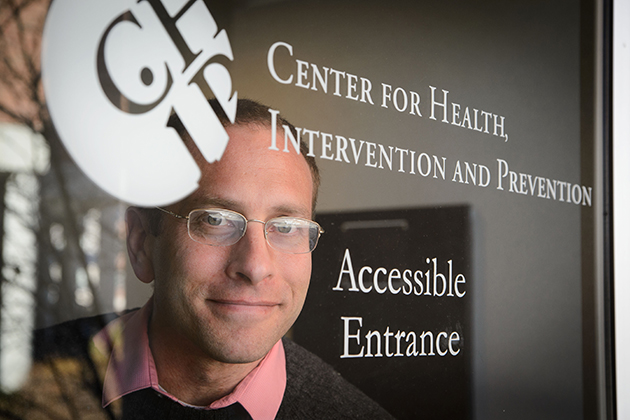 Ph.D. candidate David Finitsis, an affiliate of CHIP, conducted a meta-analysis that identified the health benefits of text messaging between providers and patients. (Peter Morenus/UConn Photo)
