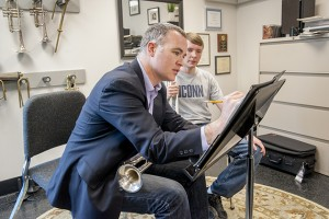Louis Hanzlik gives one-on-one instruction to Sean Sonntag '18 at the Department of Music. (Sean Flynn/UConn Photo)