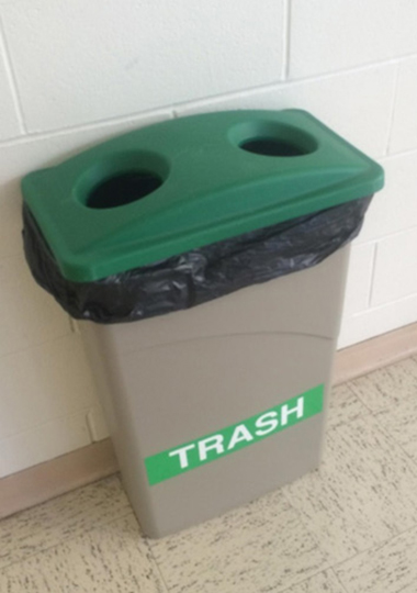 An EcoHusky student captured this photo during a recent waste audit in an older classroom building. Someone had mislabeled this recycling bin, which should have had a trash bin next to it. Once recyclables have been commingled with trash, the entire container will most likely end up as trash. (UConn Office of Environmental Policy Photo)