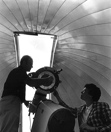 Peterson pictured in the East Road Observatory, with machinist Richard Mindek, who built the facility in the late 1970s. (Photo courtesy of Cynthia Peterson)