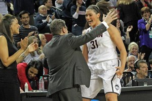 Head Coach Geno Auriemma congratulates Stefanie Dolson as she leaves the court with a minute left in the game. (Bob Stowell for UConn)