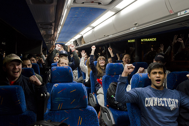 Students cheer on the bus from Storrs to Arlington, Texas for the Final Four this weekend on Oct. 8, 2013. (Ariel Dowski/UConn Photo)