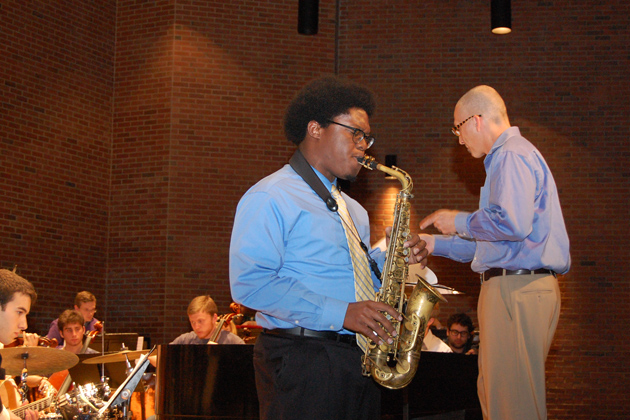 Colin Walters '14 (SFA) plays an alto saxophone solo during Dolphy Dance. (Ken Best/UConn Photo)