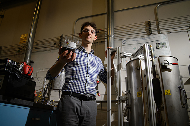 Ari Fischer '15 (ENG), a Udall Scholarship winner, in the lab at the UConn Center for Clean Energy Engineering. Fischer is one of three UConn students who have won prestigious national scholarships recently. (Peter Morenus/UConn Photo)