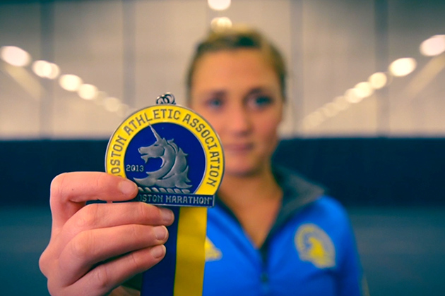 Kali Cika '15 displays the medal she earned for running the Boston Marathon in 2013. She was fortunate to complete her run before the bombs went off. (Angie Reyes/UConn Photo)