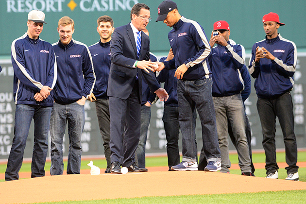 Gov. Dannel P. Malloy hands Shabazz Napier the ball, as the Huskies look on. (Boston Red Sox Photo)