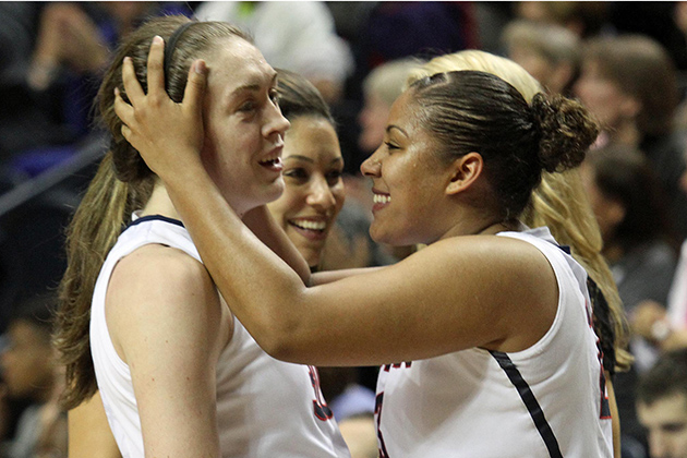 Kaleena Mosqueda-Lewis '15 (CLAS), right, congratulates teammate Breanna Stewart '16 (CLAS). Stewart was the leading scorer, with 21 points. (Bob Stowell '70 (CLAS)