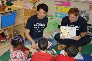 "UST scholars work with children at ""Brushing Bunny"" program events in an effort to improve their oral health. (Photos provided by Petra Clark-Dufner)"
