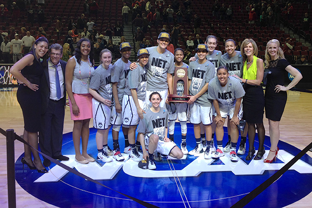 The Women's Basketball team pictured with the NCAA East Regional Trophy after winning their game Monday night against Texas A&M. They will face either Stanford or North Carolina in the national semifinal in Nashville, Tenn. on Sunday. (Bob Stowell for UConn)