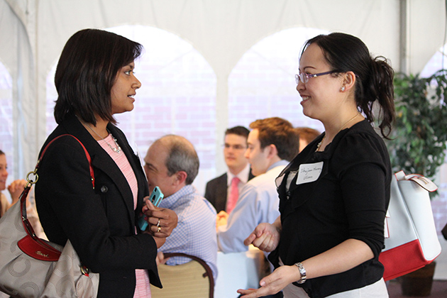 Milanthi Sarukkali, actuary at ING, talks with Shujuan Huang, a UConn actuarial science student, at the recent Student Actuarial Research Conference, sponsored by the Goldenson Center for Actuarial Research. (Christine Buckley/UConn Photo)