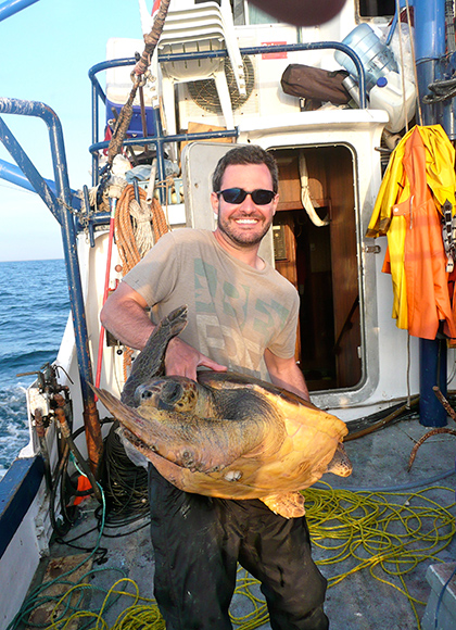 UConn alum Jesse Senko '06 (CANR) is developing solutions that help both the endangered sea turtles and the local fishermen. (Photo courtesy of Jesse Senko)