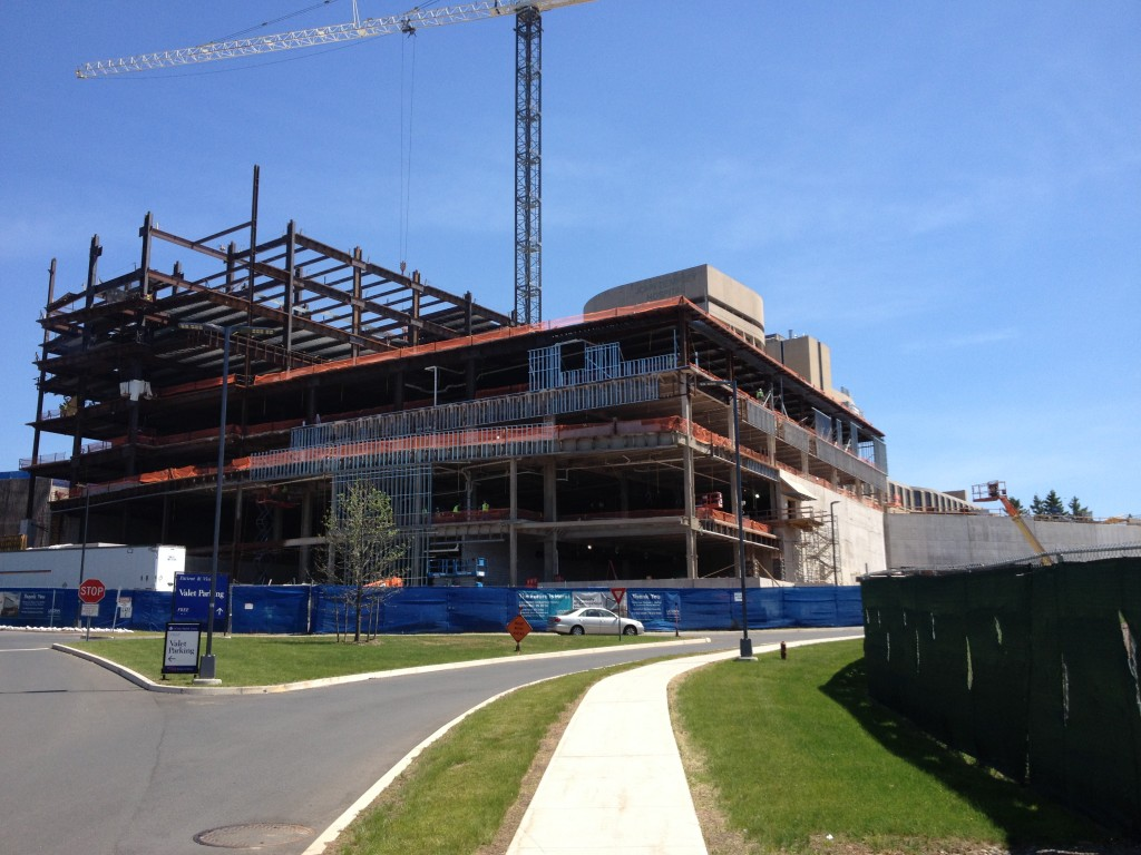 The new hospital tower under construction at the top of the hill is scheduled for completion in early 2016. (Chris DeFrancesco/UConn Health Photo)