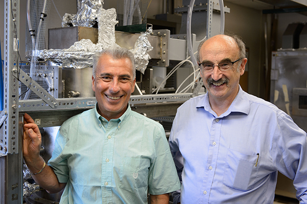 Baki Cetegen, left, head of the Department of Mechanical Engineering and the School of Engineering's United Technologies Chair, and Eric Jordan, United Technologies Professor of Advanced Materials Processing, at the office of Amastan at the Depot Campus on June 30, 2014. (Peter Morenus/UConn Photo)